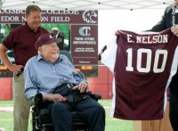 Edor Nelson '38 was presented a special jersey in honor of his 100th birthday.