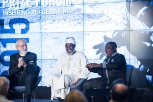 Rev. Mark Hanson, left, moderates a panel at the Nobel Peace Prize Forum with Imam Muhammad Ashafa and Pastor James Wuye.