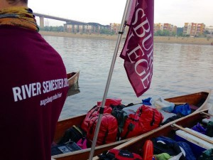 River semester canoes filled with trip gear