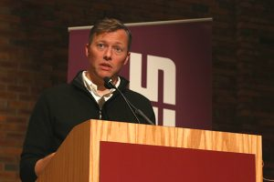 Matthew Desmond speaking at Augsburg University