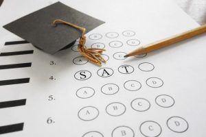 SAT test bubble sheet with a graduation cap and pencil