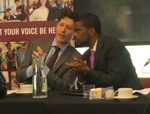 Mayors Jacob Frey and Melvin Carter at the debate discuss the finer points of civil debate.