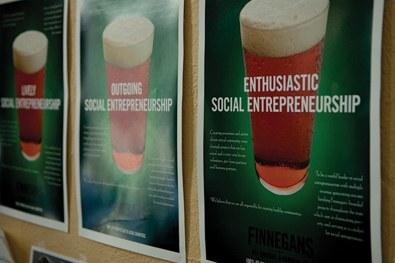 Finnegans posters on a wall.