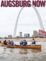 Spring 2016 Issue cover. Features students in a canoe with an Augsburg College, in front of the St. Louis Arch