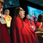 An ensemble of Native American women sings on International Women's Day to honor and raise awareness of those Native American women who are victims of violence.