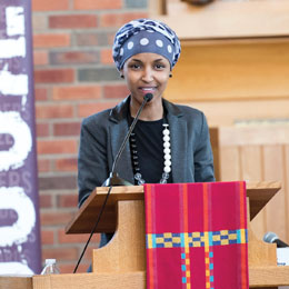 Keynote speaker and debate judge Ilhan Omar encourages Somali Debate Initiative guests to pursue college degrees.