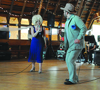 Darcey Engen '88 and Luverne Seifert '83 perform as Aunt Woo and Uncle Yahoo.