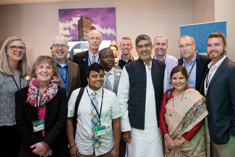 [L to R]: Jacqueline deVries; Margaret PowellMack '17 MAL; Kevin Stirtz '17 MAL; Subashini Ambrose '18 MAL; Tom Morgan; Eric Miamen '04, '14 MBA, '16 MAL; David Nyssen '16 MBA, '17 MAL; Nobel Laureate Kailash Satyarthi; Howie Smith '80, '19 MAL; Satyarthi's wife, Sumedha Kailash; MAL Director Alan Tuchtenhagen; and Brad Beeskow '17 MAL.