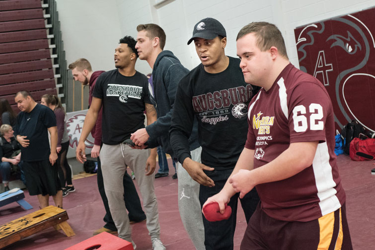 Augsburg student-athletes play basketball and bean bag competitions with Special Olympics athletes