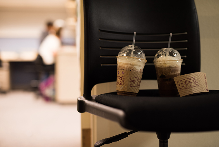 Coffee drinks sit outside lab space on chair