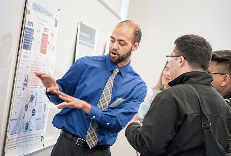 A student presents his research at the annual Zyzzogeton event