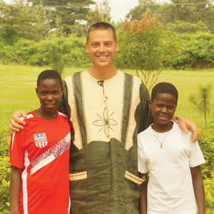 Brian Kuhl with Ugandan children