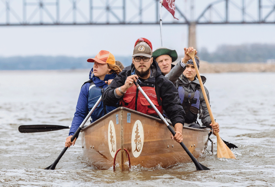 Students canoe down the Mississippi River