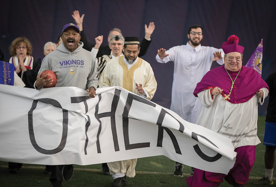 Faith leaders from across the Twin Cities and former Minnesota Vikings player