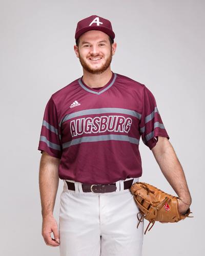 Donovan Tomony shows off the new baseball jerseys