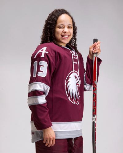 Nikki Nightengale shows off the new hockey jerseys