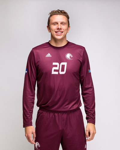 Daniel Hedstrom shows off the new soccer jerseys