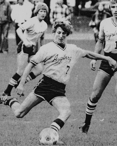 Photo of Mike Kennedy playing soccer when he attended Augsburg University