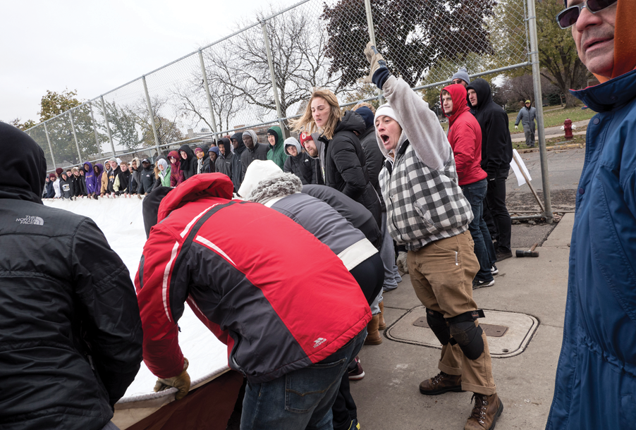 Augsburg community members helping to assemble the dome