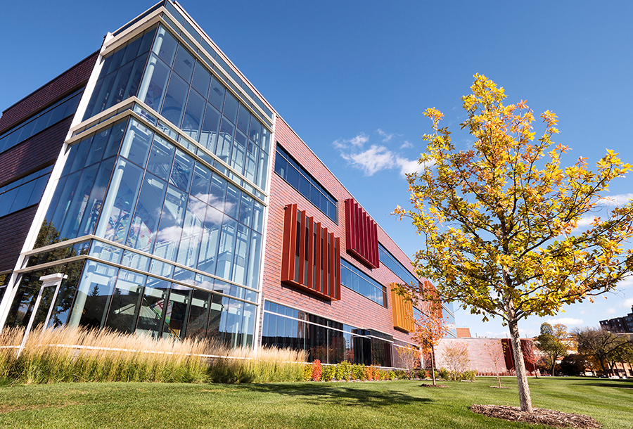 Augsburg newest building, Hagfors center reflecting the clouds in the sky and fall colors.