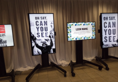 Screens displaying art and messaging about the Nobel Peace Prize Forum topic, Paradox of Peace
