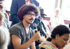 A student asking a question at a breakout session