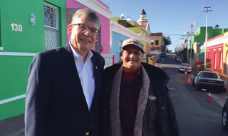 Augsburg University President Paul Pribbenow stands with Cape Town with guide Shireen Narkedien while in Namibia