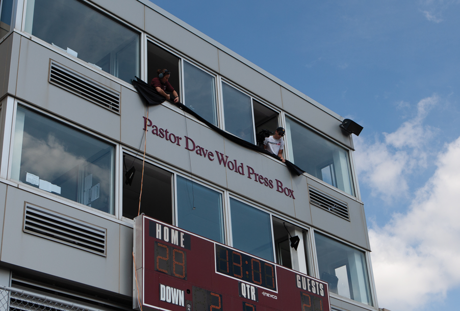 Press box showing the new name, Pastor Dave Wold Press Box
