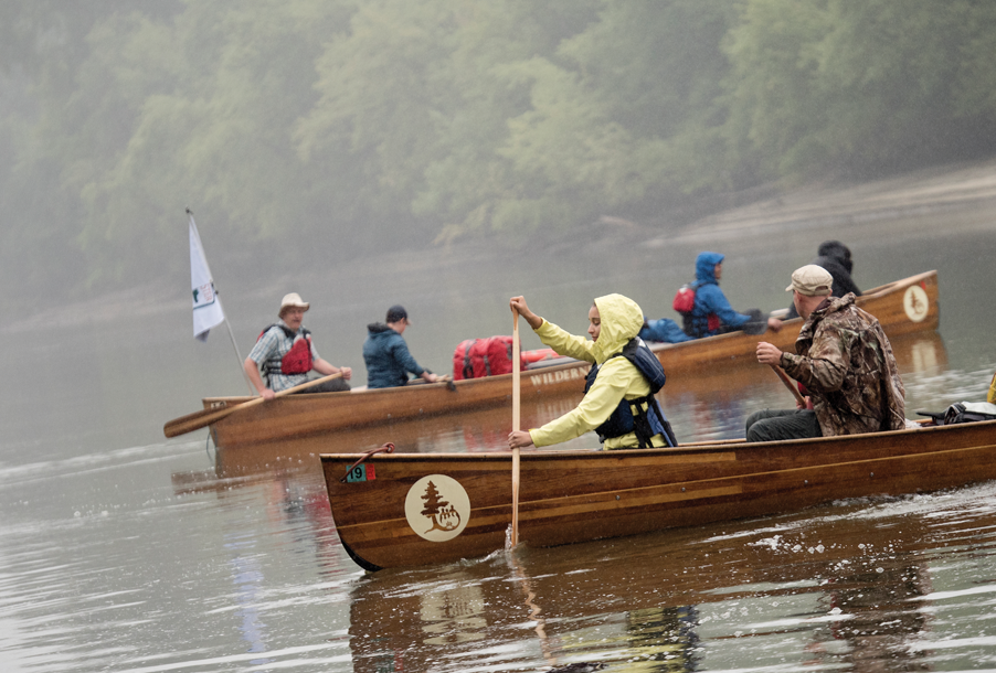 Students canoeing on the river