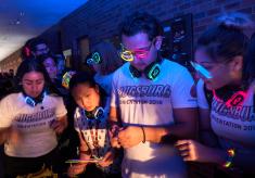 Students wearing glow stick sunglasses