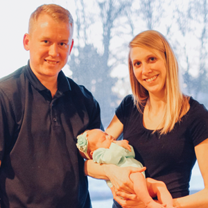 Rick, Ashley, and baby Wolke photographed together