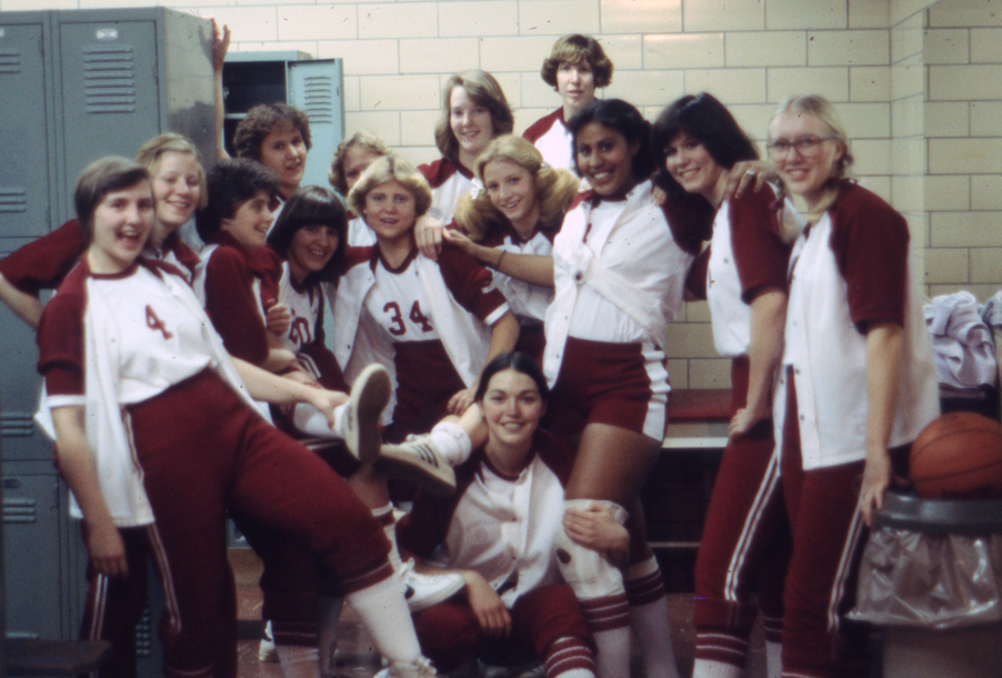 Archival photo of the Augsburg women's basketball team posing for a photo in the locker room, 1978.