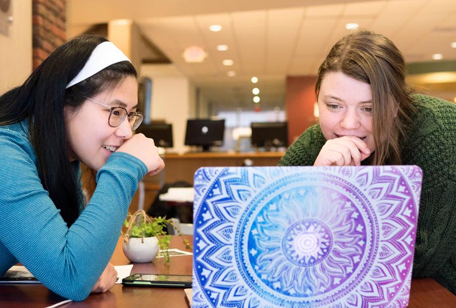 Camryn Masse, left, and Jen Meinhardt study together