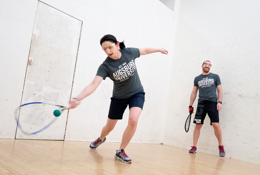 Maggie Sotos, left, and Josh Owens, right, playing racketball