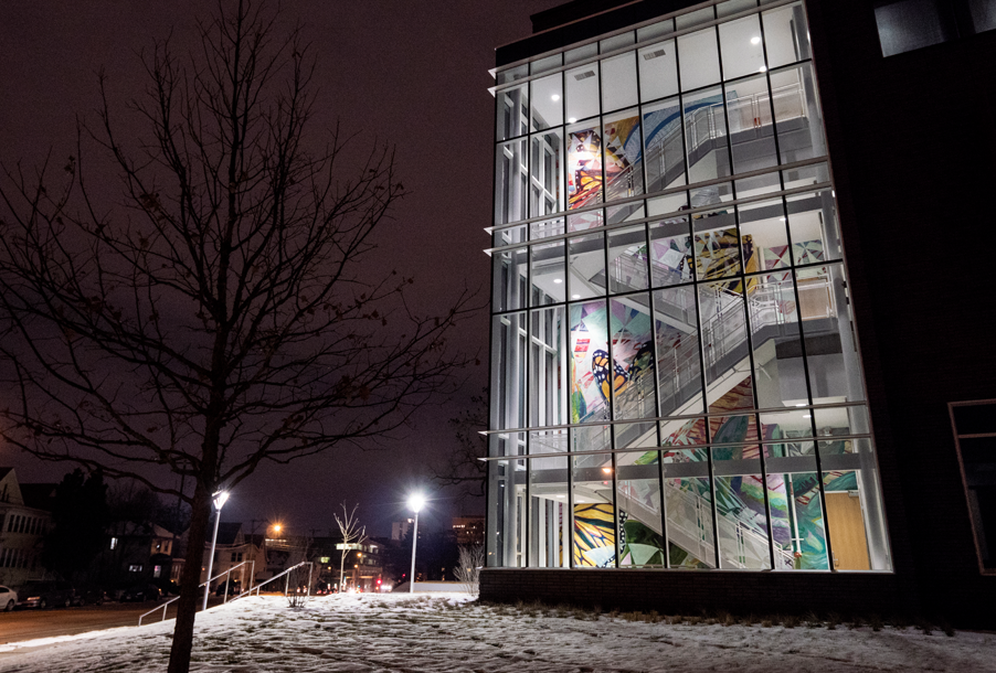 """The three-story mural """"Emergence"""" adorns the Hagfors Center's west stairwell."""
