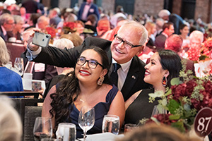 Minnesota Governor Tim Walz, a guest speaker for the evening, takes a selfie with Augsburg Day Student Government leaders Arianna Antone-Ramirez '20 and Lucia Davila '20.