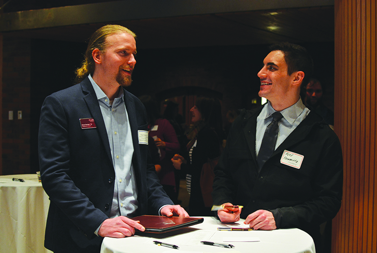 Two men at a networking event