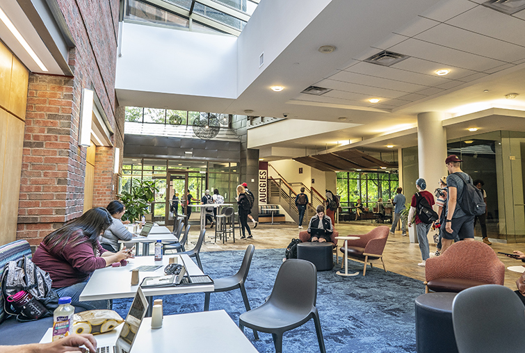 students seated in a lobby