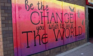 """Be the change you wish to see in the world"" quote mural"