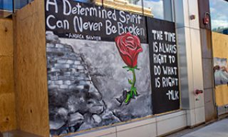 """A determined spirit can never be broken"" mural quote, and ""The time is always right to do what is right"" - MLK mural"