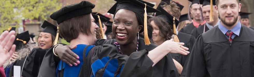 Graduate students hugging