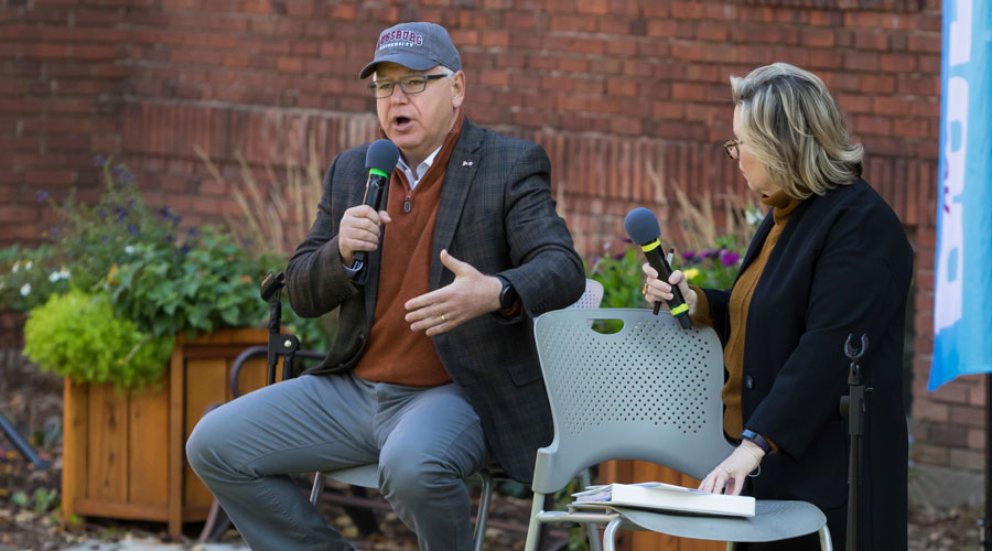 Governor Tim Walz and his wife Gwen Walz speaking for the Augsburg Bold series in the quad