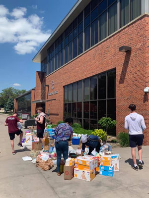 Students and staff collecting supples in front of Si Melby Hall