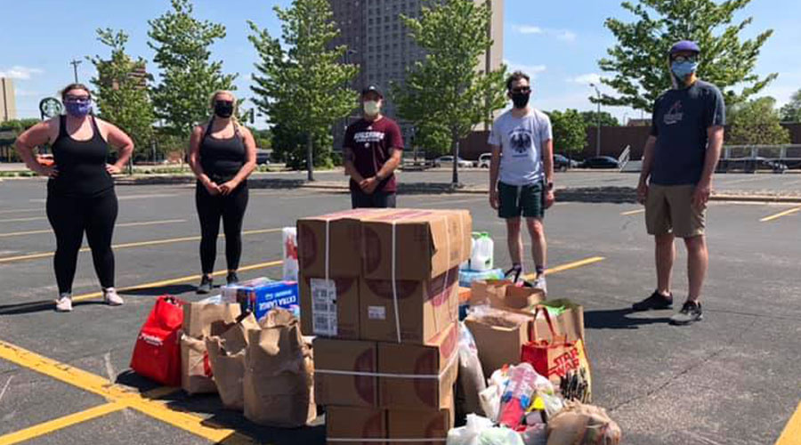 Students and staff in parking lot L gathering supplies to donate