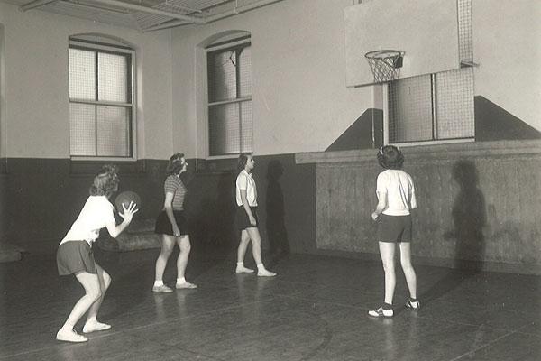 Auggies shoot hoops in Old Main gymnasium, circa 1945.