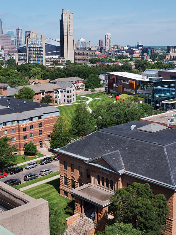 Augsburg University's campus in 2018. Old Main with the Minneapolis skyline in the background.