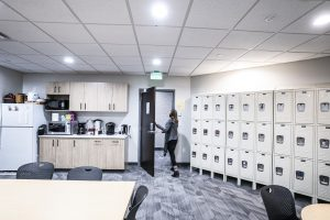 Student lounge with lockers on right wall. Lower and upper cabinets are in background.