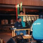 An unidentified Black man performing at an event in Hoversten Chapel, 1990