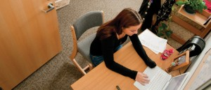 Student studying at desk in residence hall