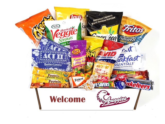 care package filled with snacks like chips, popcorn, and candy